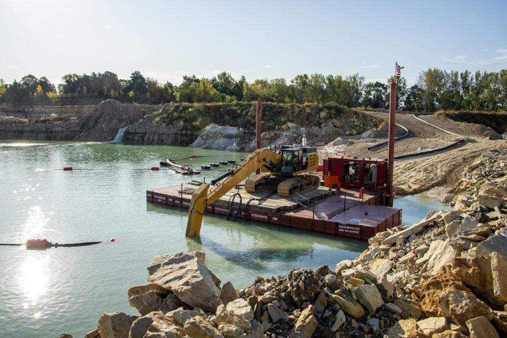 P1 5ft barges used with an excavator armed with an Eddy Pump performing sand dredging